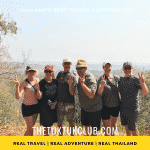 Six people on a Tuk Tuk Adventure in Thailand standing at a viewpoint over the moutains
