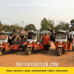 Three Tuk Tuks with 6 women smiling and standing by them after having learned to drive the Tuk Tuks