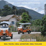 Two Tuk Tuks going round a corner through a small village in the mountains of Northern Thailand