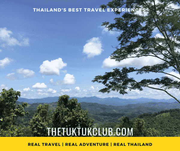 Views over the mountains with blue skies and fluffy clouds in Thailand
