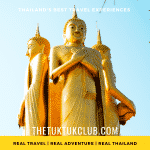 3 giant golden Buddha images set against a bright blue sky
