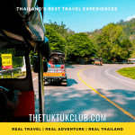 A view from the side of a Tuk Tuk as a traveller drives along a quiet mountain road in Northern Thailand