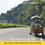 Three Tuk Tuks parked on the side of a mountain road in Mae Hong Son, Thailand