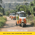 A convoy of three Tuk Tuks travelling along a small road in the forests of Chiang Mai