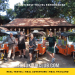 Four travellers standing next to three Tuk Tuks about to set off on a Tuk Tuk Adventure