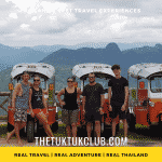Five adventurous travellers standing in front of four Tuk Tuks with the mountains of Mae Hong Son in the background
