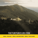 A mountain top Temple in Northern Thailand perched on a mountain ridge surrounded by forest