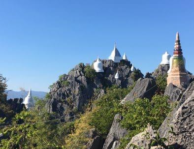 White chedis on mountain peaks