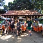 Three Tuk Tuks with travellers in a small rural resort