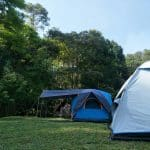Two tents in a forest clearing in Thailand