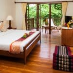 A hotel room with bed and balcony in Mae Sariang